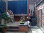 Adrian Litvinoff and Dave Balen enjoyi lunch in the sunny courtyard at the Shoe Factory